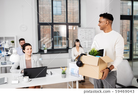 happy male office worker with personal stuff 59469043