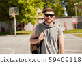 man with backpack at street basketball playground 59469118