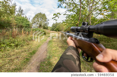 POV of male hands shooting with air rifle 59469358