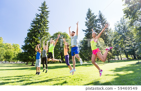 group of happy friends jumping high at park 59469549
