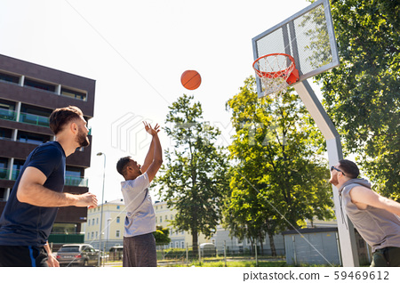 group of male friends playing street basketball 59469612