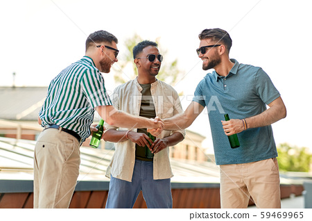 happy male friends drinking beer at rooftop party 59469965