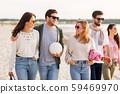 happy friends walking along summer beach 59469970