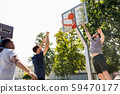 group of male friends playing street basketball 59470177