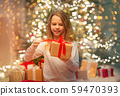 smiling girl with christmas gift at home 59470393