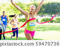 happy young female runner on finish winning race 59470736
