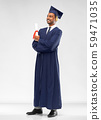 male graduate student in mortar board with diploma 59471035