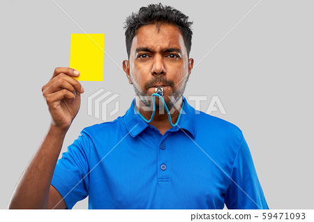 indian referee whistling and showing yellow card 59471093