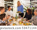 happy family having dinner party at home 59471144