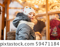 happy little girl at christmas market in winter 59471184