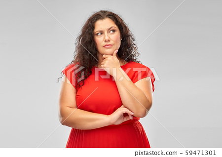serious woman in red dress thinking 59471301