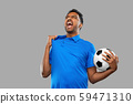 angry indian male football fan with soccer ball 59471310