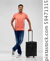 smiling indian man in polo shirt with travel bag 59471315