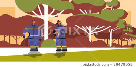 brave firemen rescuing cat firefighters couple wearing uniform and helmet firefighting emergency 59479059