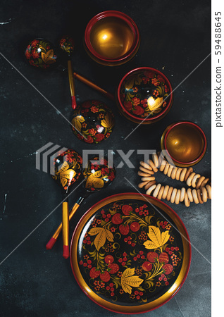 Russian khokhloma, traditional wood painting handicraft souvenirs top view 59488645