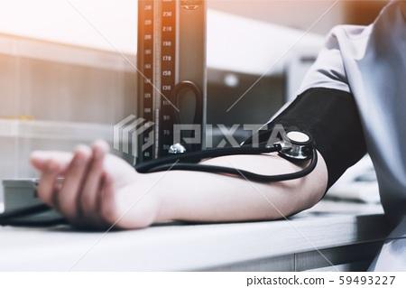 Nurse check blood pressure Patient in hospital 59493227