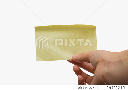 Woman holding a blank yellow sticky note isolated on white background, space for text 59495216