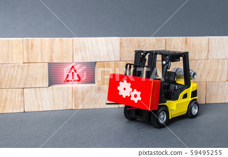 A forklift truck brings a red block to a void in the wall. Repair work, elimination of gaps. Improving system security, fixing errors and bugs. Integration of solutions and problem solving 59495255