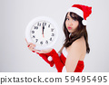 Beautiful portrait young asian woman in Santa dress holding clock with excited in xmas holiday 59495495