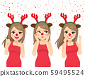 Happy dancing woman with deer headband and red nose celebrating Christmas 59495524