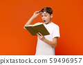 Shocked teen boy surprised by the twists and turn of story 59496957