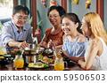 Preteen girl at family dinner 59506503