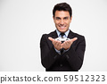 Businessman with protective gesture and car, 59512323