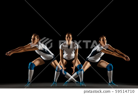 Young female volleyball player isolated on black studio background 59514710