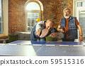 Senior men playing table tennis in workplace, having fun 59515316