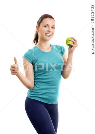 Young woman holding green apple and giving thumb 59515438