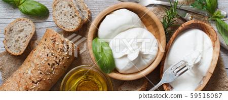 Italian cheese burrata, olive oil and bread 59518087