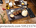 Pork tenderloin served on a board in restaurant 59523374