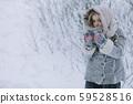 cute little girl in the woods in winter. snowing 59528516
