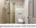 Bathroom in the apartment with a small shower. 59530364