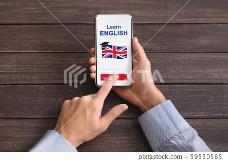 Man Hands Downloading Application For Learning English On Smartphone 59530565