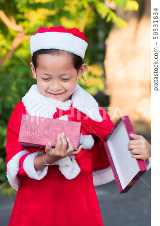 Asian happy child girls in santa claus hats with 59531834