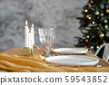 Table is served for a Christmas dinner in the living room, close-up view, table setting with a 59543852