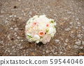 Wedding bouquet lying on grey carpet during preparation before celebration. Side view of decorative 59544046