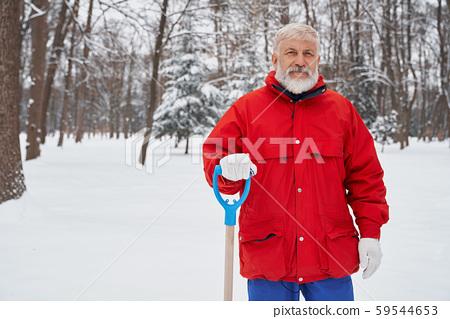 Portrait of elderly janitor of city service. 59544653