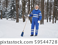 Cleaner in work overalls with broom. 59544728