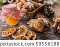 Gingerbread christmas cookies with jar of honey on 59556188