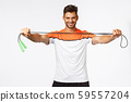 Handsome energized fitness instructor giving jump rope, instruct how lead active and healthy 59557204
