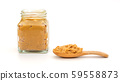 Peanut butter in a spoon and bottle 59558873