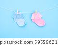 Baby socks on blue background. 59559621