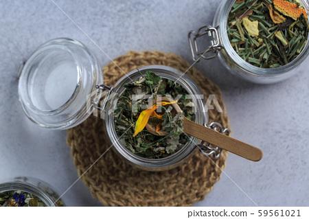 herbal tea in glass pot on grey 59561021