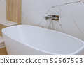 A modern marble tile bathroom with bathtub during 59567593