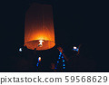 Lighting candles, lanterns in the sky at night in 59568629