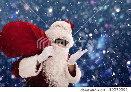 Santa Claus carrying sack full of gifts 59570593