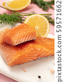 Slices of salmon with lemon and dill, close-up with salt and pepper, cooking fish, on a pink 59571662