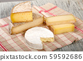 Different french cheeses on a towel 59592686